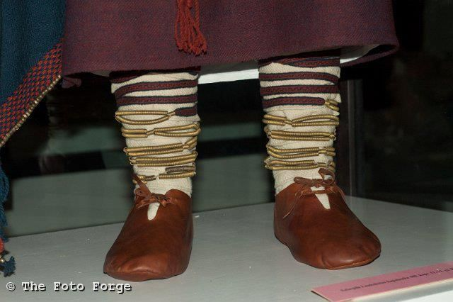 Leather shoes similar to Viking footwear, but note the unusual combination of bronze spirals and card-woven trim for the leg-wraps.