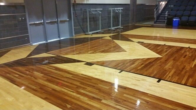 Auditorium floor in Belvidere, IL. Made out of Maple, Cherry, Walnut and Ebony wood. Just beautiful. Upgrading to LED lighting.