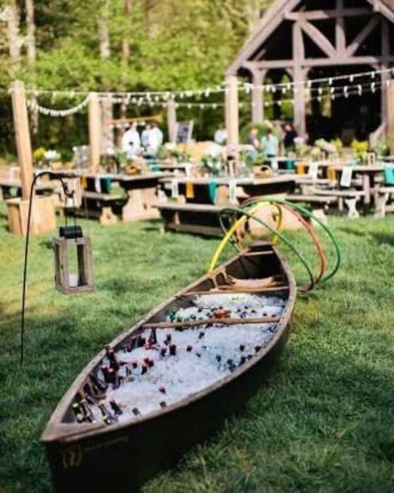 Outdoor Canoe Wedding Bar Ideas http://www.deerpearlflowers.com/rustic-canoe-wedding-ideas/