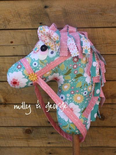 Handmade, hobby horse, floral fabrics, aqua and coral,. $85.00, via Etsy.