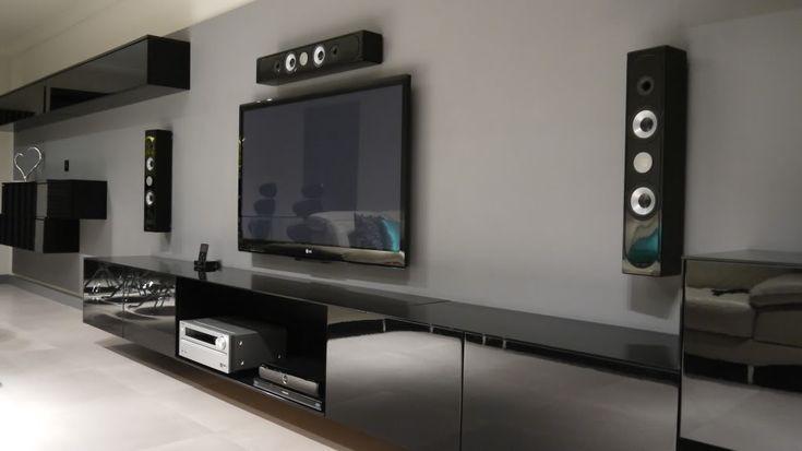IKEA Besta floating TV unit with custom cut black glass tops & shelf spanning 2x 1200mm wide units.
