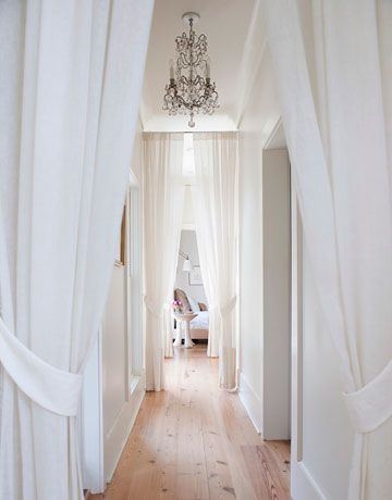 draped hallway: White Houses, Curtains, Houses Beautiful, Idea, White Design, White Spaces, Hallways Lights, Long Hallways, Narrow Hallways