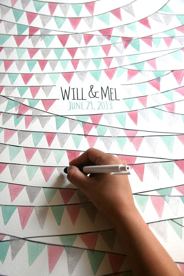 This guest book alternative can double as a decor element. Personalize this poster with your names and wedding date and customize the watercolour buntings to match your colour palette. Then have each guest sign a flag.    Photography courtesy of  OnceUponaPaper on Etsy .