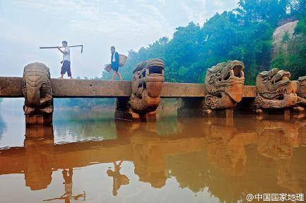 An ancient Dragon Head Bridge on Nine Turns River, Sichuan Province.   There are four types of creatures carved on the bridge piers: Chinese dragon (loong), Chinese unicorn (qilin), lion and elephant.