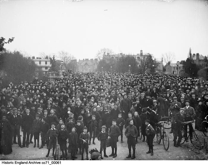 CC71/00061 A large crowd gathered on Magdalen Bridge, Oxford, on May Morning to hear the college choir sing from the top of the tower, an annual tradition. PlaceOxfordshire  Date1895 Photographer: Henry W Taunt