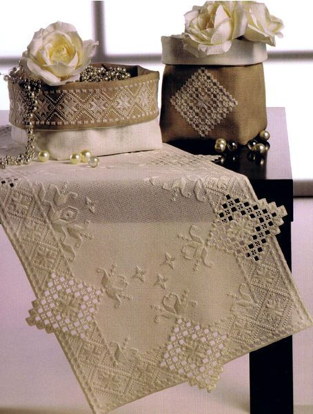 Four attractive hardager designs for table runner, doily and basket covers.