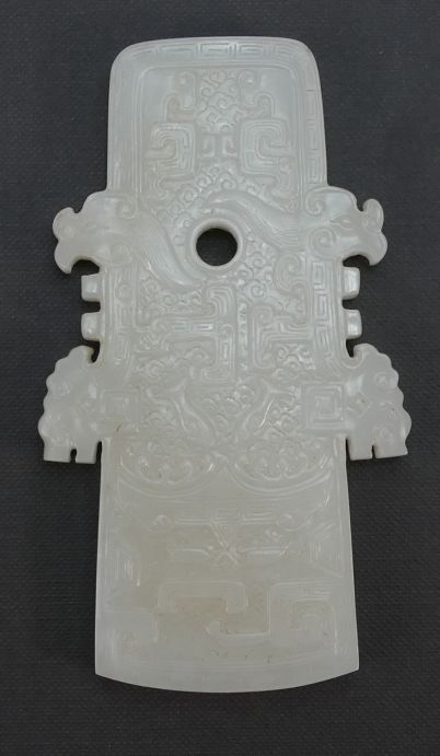 Rare 20th century Pottery, Antique, Collectors and Fine Art Auction – Lot 896 – Qing Dynasty (1644-1911) A Chinese white Jade dragon pendant, length 10.3cm.  Sale Price £4,000.00.