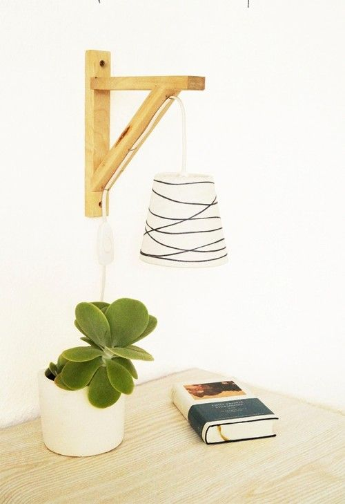 This simple wall lamp will be perfect for a working space, a bedroom in case you have no place for a table lamp, or a cozy reading nook. To make one you'll need transparent glue, scissors, yarn, a big craft stapler, a small lamp shade, a bulb holder with cable and an EKBY bracket. Cut...