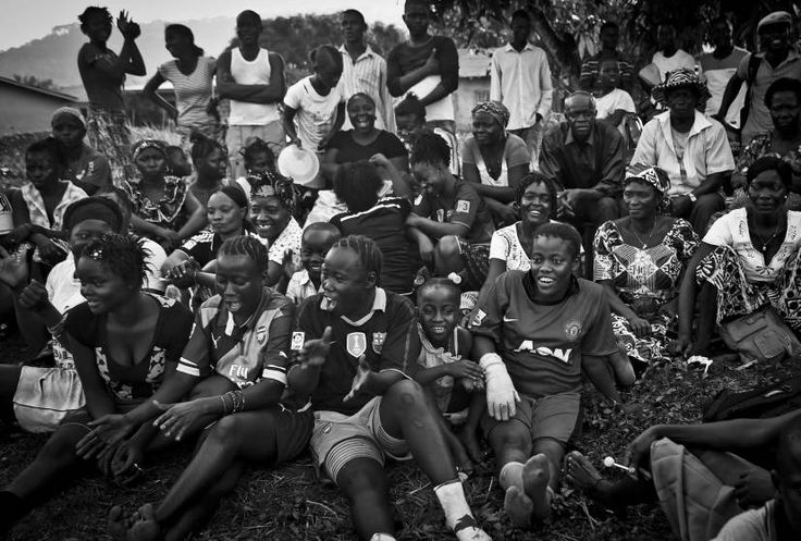 Sports, 3rd prize stories. Residents of Freetown cheer for the Ebola Survivors Football Club on a field in the city of Kenema, Sierra Leone, April 21, 2015.