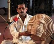 Vellinezhi Ramankutty Asan is the sole surviving practitioner of the traditional manner of making the 'koppu,' the accessories and head gear for traditional performing arts of Kerala. Made from kumbil wood.