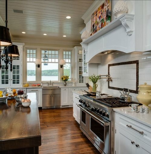 This kitchen is really growing on me, just take out the panes on the windows and the country touches  House on Lake Michigan | hookedonhouses.net