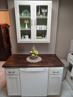 http://thepreciouslittlethingsinlife.blogspot.com/2011/05/diy-dishwasher-cabinet.html