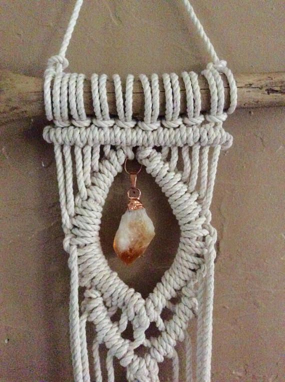 Macrame plant hanger on drift wood with a beautiful hanging crystal in the middle. This design is based off of my best selling macrame wall hanging. Who doesnt love crystals? It is a combination of macrame wall hanging and plant holder. You can hang it on your wall and it looks so