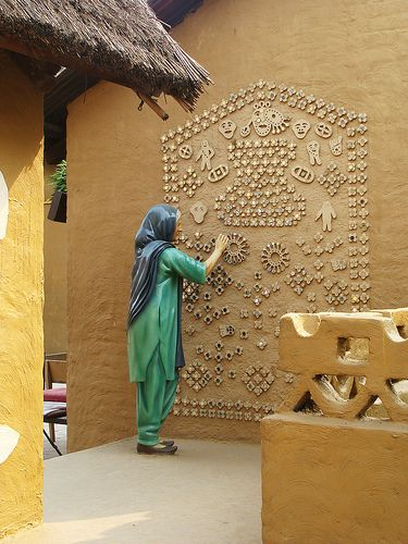 India's rural wall art... look closely, there r mirrors in each flower