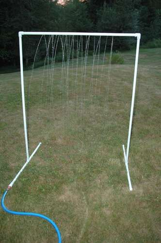 PVC Sprinkler Water Toy - how smart is this? $10 worth of materials from the hardware store will bring lots of joy this summer. :)  And move it around the yard to water the lawn while the kids play!