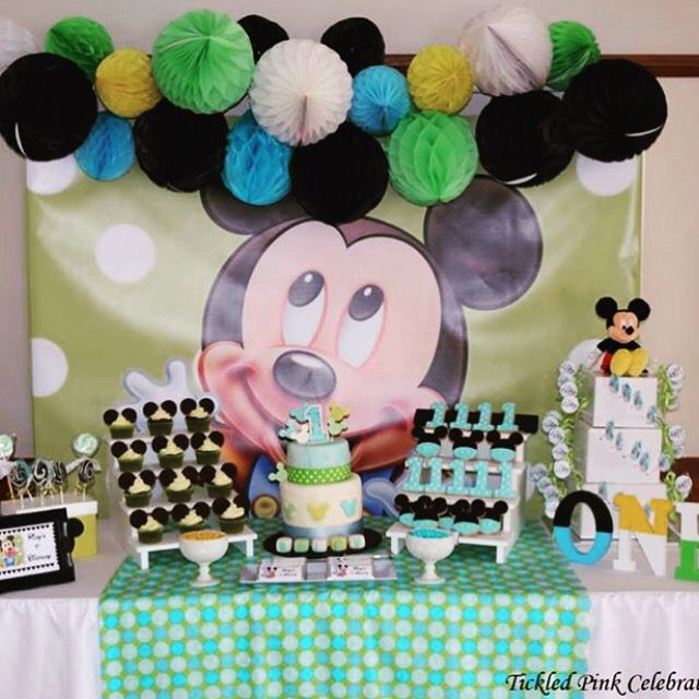 Baby Mickey Mouse 1st birthday party table styled by @tickledpinkcele