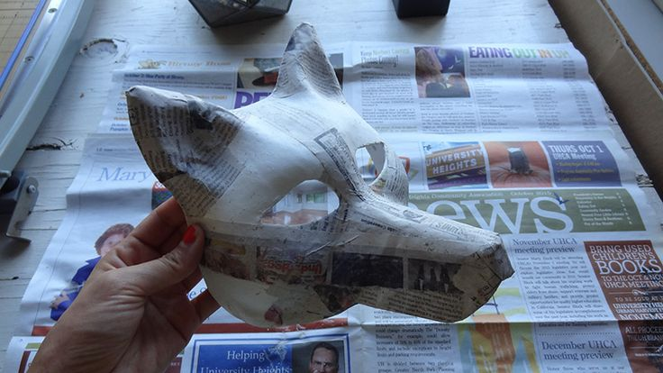 dried paper mache wolf mask More