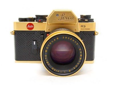 The Leica R3 Gold with 50 1.4 lens. These were produced in 1979 to commemorate the 100th birthday of Oskar Barnack, the inventor of the Leica camera. Body is covered in black lizard skin and 24 carat gold plated with matching gold plated lens. Edition of 1,000 produced.