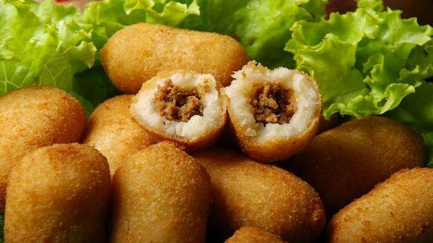 Carimañolas: fritters made of cassava stuffed with meat, PANAMA FOOD.