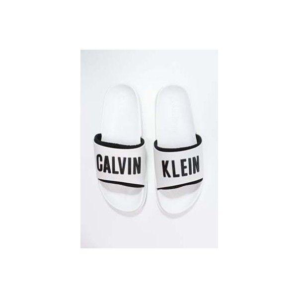 Calvin Klein Swimwear SLIDE ❤ liked on Polyvore featuring shoes, calvin klein footwear, white mule shoes, white mules, white shoes and calvin klein shoes