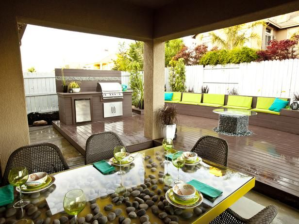 Upscale and Up-cycled---This backyard makeover included the creation of an outdoor dining space and adjacent 100-foot deck.