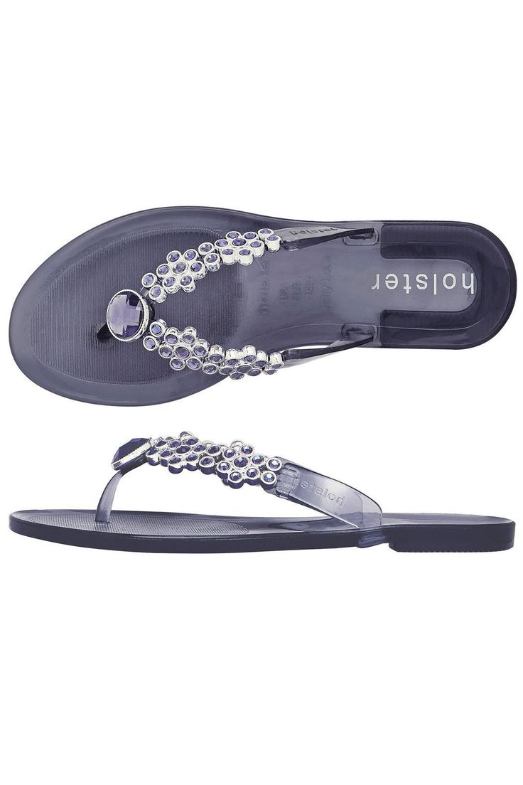Bloom flipflop style sandal in 'midnight' from Holster the Worlds No.1 fashion jelly brand.Also great for beach weddings!! Holsters are vegan friendly non-marking odour resistant easy to keep clean and non-sweating they also have arch supports and have been endorsed by Peter Hogg the Australian Olympic physiotherapist for actually being good for your feet.Shoe sizes are UK. UK 3 = US 5; UK 4 = US 6; UK 5 = US 7; UK 6 = US 8; UK 7 = US 9; UK 8 = US 10; UK 9 = US 11 Holster Bloom Sandal by…
