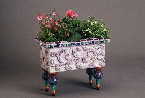Grapevine Garden Urn – Plum Art Mosaics 28″ h x 16″ diameter garden urn. Glazed ceramic. Terracotta substrate. Footed Flower Box – Plum Art Mosaics 12″ h x 14″ w…