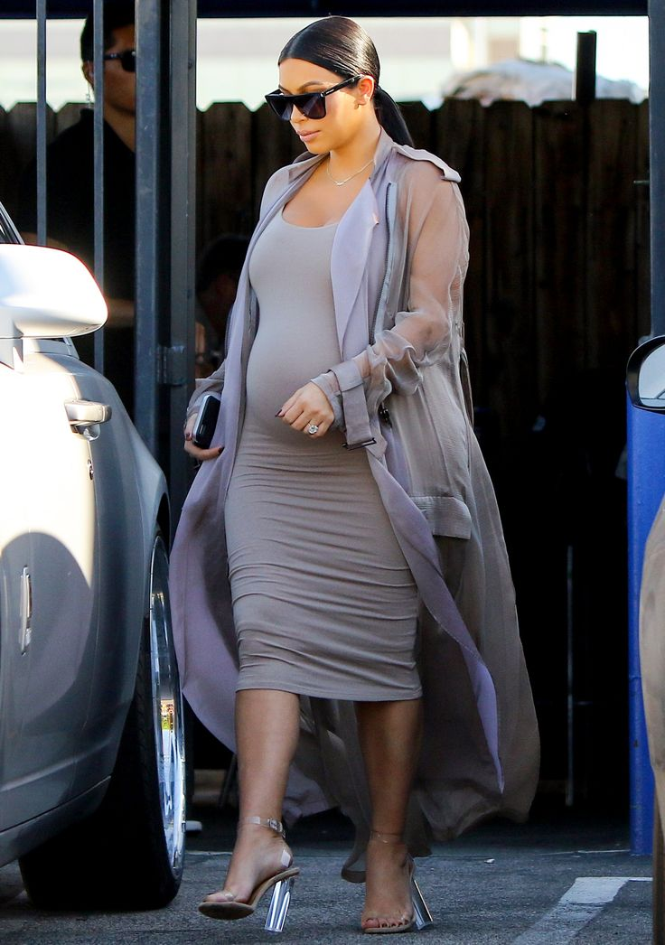 We will always love Kim's bodycon dresses during her pregnancy days.