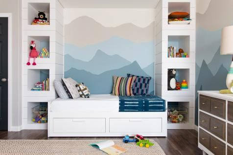 Painted wall feature built in bookshelves and under bed storage