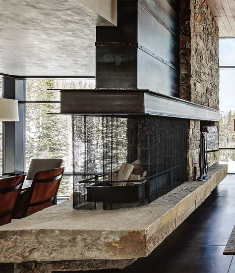 this stone and metal fireplace is GORGEOUS! either in living room or dividing my library and Marlin's gaming room/ control room.