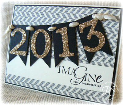 """Image the possibilities for the new year with this handmade card!  Pennant flags and sparkle numbers are tied on with a """"rope"""" for a nautical theme."""