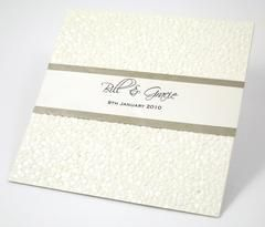 This classic wedding invitation features embossed pebbled paper with the couples names printed on a 2 layer paper strip  This wonderful invitation can be printed on a selected range of cards and modified to suite your color theme or individual events  Inspired Design is highly regarded for their beautiful designs, quality and customer service.  We are located in Australia and can deliver world wide