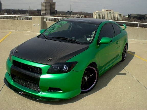 Green 2005 Scion tC with body kit wheels and carbon fibre hood