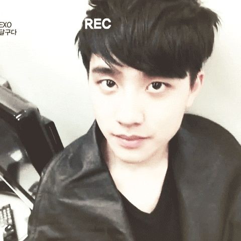 Is Baekhyun behind the camera?   Poor D.O.. He doesn't look enthused at the moment.. But wow, the gorgeous big eyes...