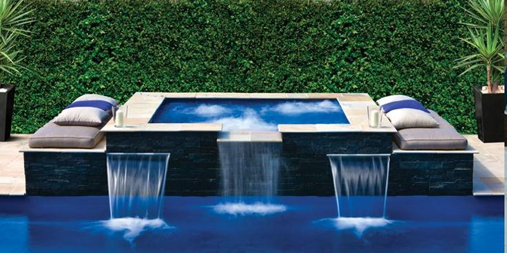 rectangle pool with square hot tub | The Sorrento Spa is a modern contoured spa with strategically placed ...