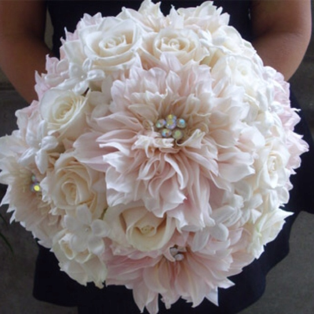 Carolyn, I like these for the bridesmaids flowers---but instead of the light pink, have a lighter purple with the cream colored ones.... and also had some diamond type accents. I want the girls to have diamonds and me to have pearls. The stems for the bridesmaids can be wrapped in black lace.