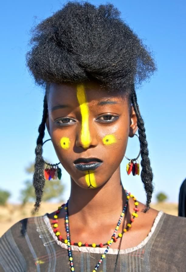 The Wodaabe are a small subgroup of the Fulani. TheWodaabes male charm dancer applies face make-up to attract the females who will judge his performance.