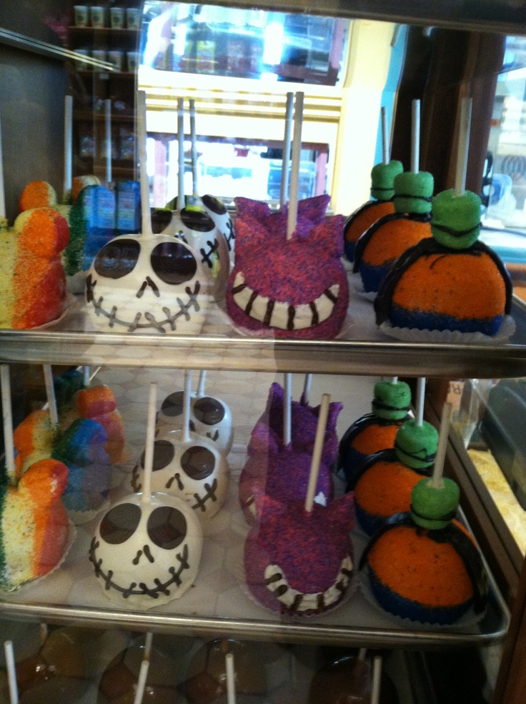 Awesome caramel apples from Buena Vista Street/Cars Land preview at CA Adventure. Rainbow glitter Mickey, Jack, purple/pink glitter Cheshire cat, and Goofy. 6/9/2012
