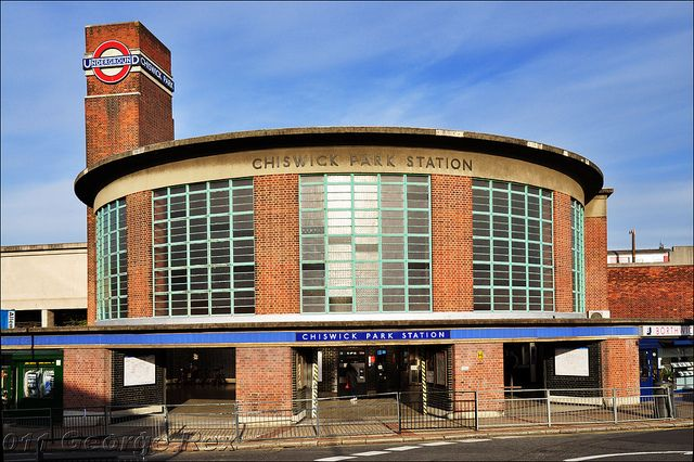Chiswick Park Station, on London Underground's District Line. It is one of the handsome stations designed by Charles Holden in the 1930s, and the London Underground signage is well integrated with the architecture of the station.