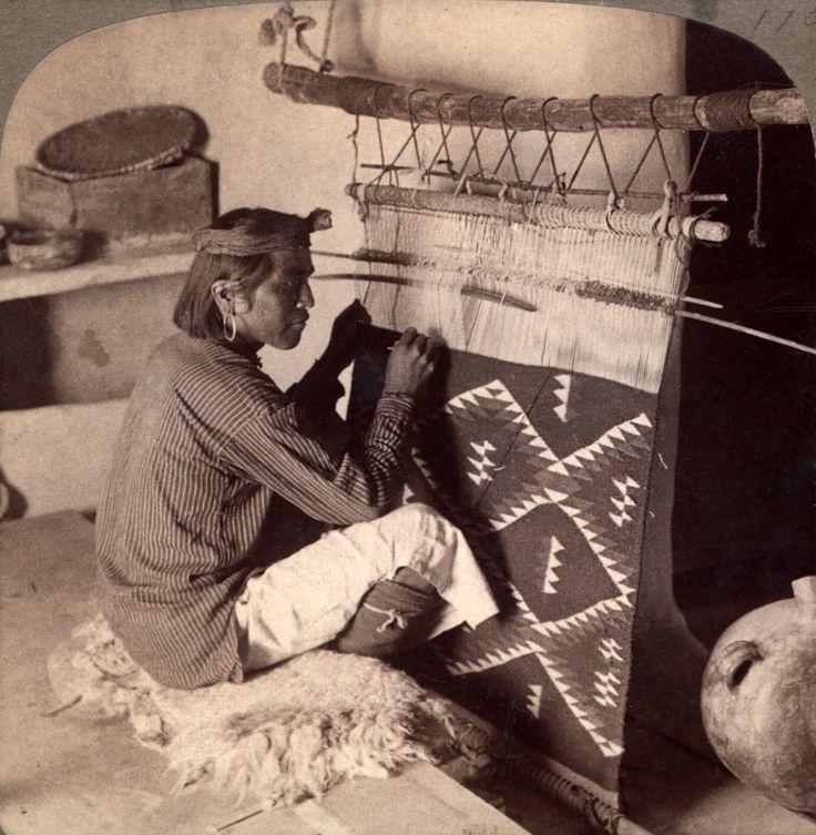 Hopi native weaving a blanket.