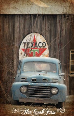 an old Ford & a Texaco gas sign