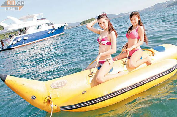inflatable banana boat  2 people playing on the beach surf riding water game water toys