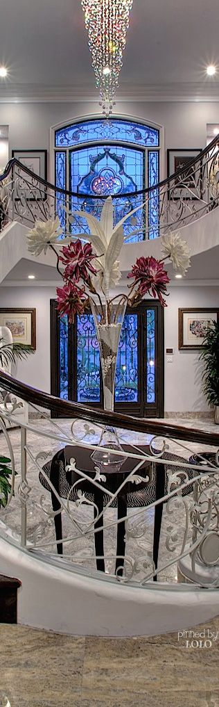 beautiful, The glass the stairs the banister the chandelier. I don't have a board like that.