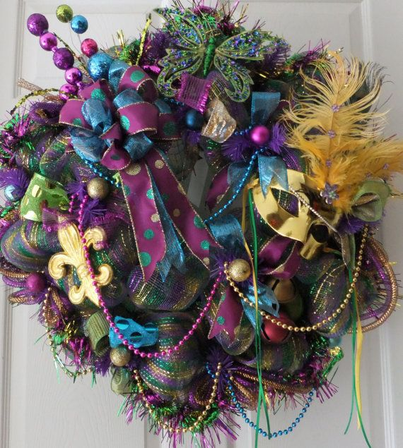 Mardi Gras Wreath - I have a gorgeous peacock Christmas wreath which I could probably covert for Mardi Gras