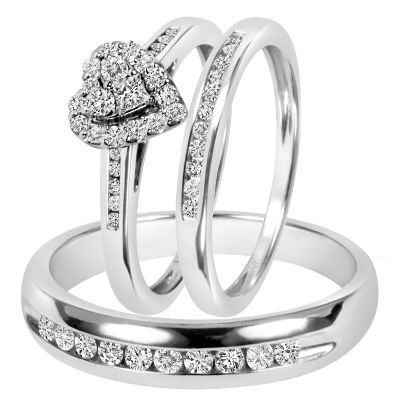 Gorgeous Matching Trio Wedding Ring Set! You might have stole her heart, here's a way to give it back to her in a way she'll cherish forever! This 3/4 Carat T.W. Diamond Women's Engagement Ring, Ladies Wedding Band, Men's Wedding Band Matching Set is made in 14K White Gold and has 48 Round cut natural, conflict free diamonds.