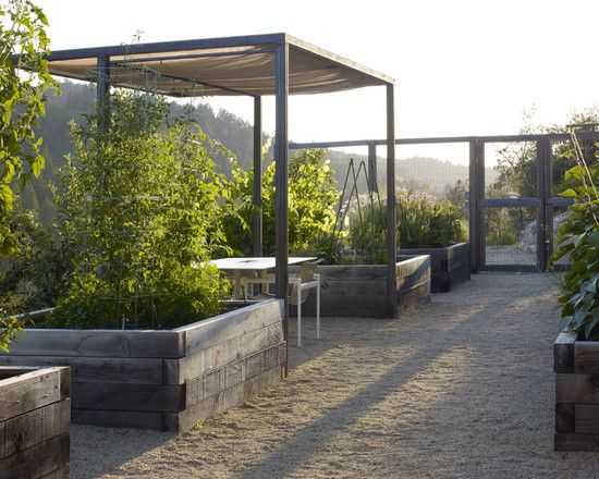 - extra tall corner posts of raised garden beds to create a canopied seating area