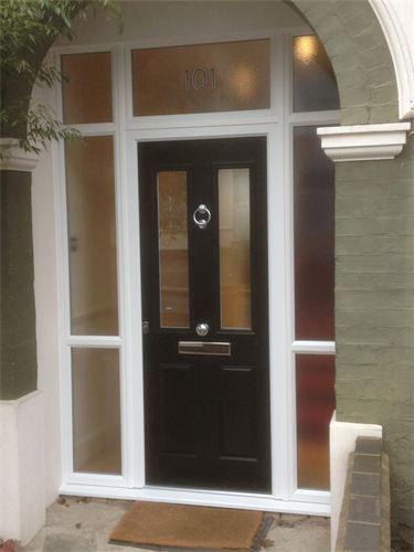 Composite door : Black composite door with glass surrounds. Custom knocker & door pull. Door works by key only with no handle on exterior. Leigh-on-Sea, Essex.