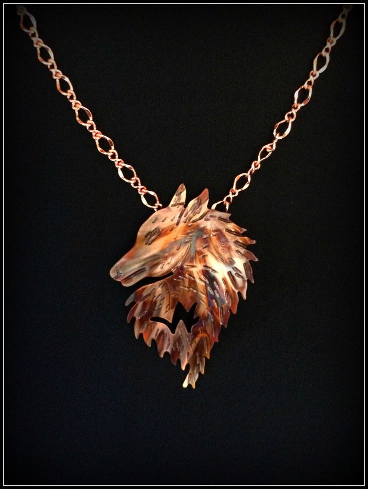 Handcrafted copper jewelry inspired by nature in my #etsy shop #wolfnecklace #wolfpendant #wolfjewelry #flamepaintedcopper #copper #etsyhandmadejewelry #marchmeetthemaker #imagesbykentolinger #etsyfinds