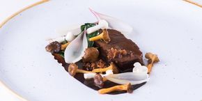 Paul Foster serves up a comforting yet elegant beer-braised beef cheek recipe, served with girolles, shimeji mushrooms and a variety of aliums.