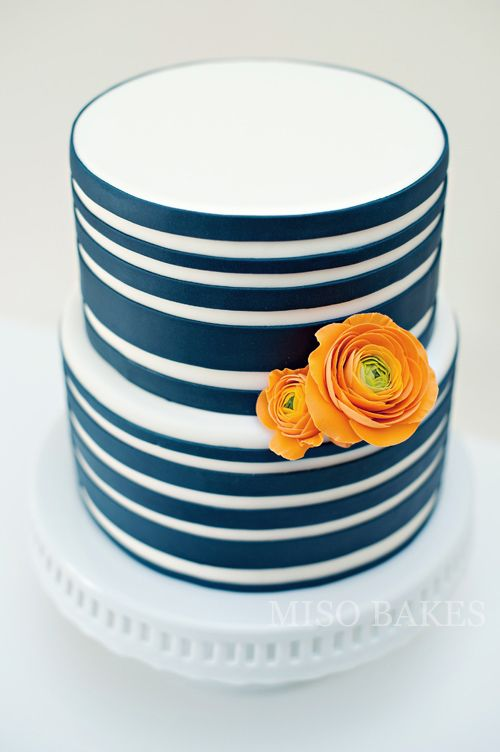 Fresh & Bright Summery Cake.  Navy blue stripes with orange sugarpaste ranunculus by Miso Bakes.